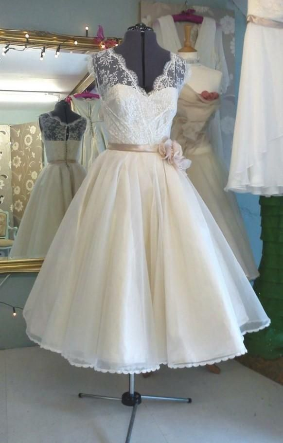 Weddbook ♥ 1950's Tea Length lace illusion neckline wedding dress. 50s button up back wedding gown with blush sash  illusion lace 50s sash