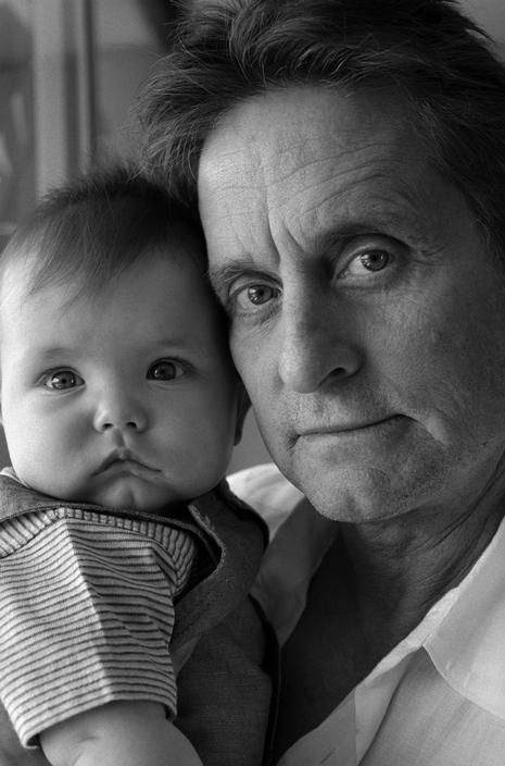 Michael Douglas at home with his baby son Dylan ~ 2001 (photo by Bruce Davidson)