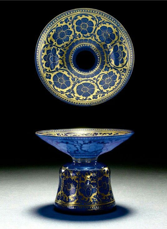 MUGHAL BLUE GLASS SPITTOON, NORTH INDIA, 17TH-18TH CENTURY finely painted in gold leaf with a design of poppy-heads and scrolling garlands.