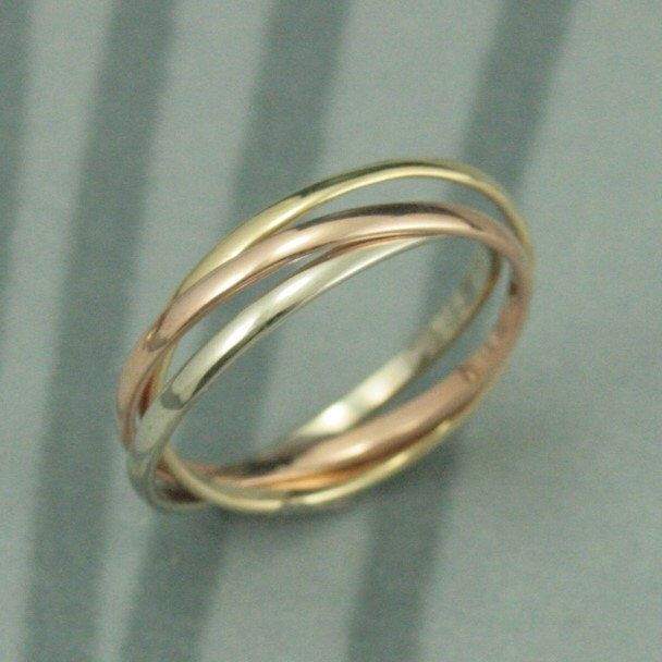 14K Tri Color Rolling Ring--Rose, White and Yellow Gold Interlocking Ring--Three 1.5mm wide Half Round Bands--Russian Wedding Band by debblazer on Etsy https://www.etsy.com/ca/listing/165374051/14k-tri-color-rolling-ring-rose-white