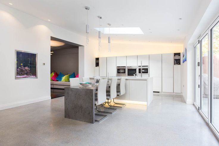 Handleless Nolte Matrix Art Kitchen - our White Nolte Kitchen sits perfectly in this open plan room.
