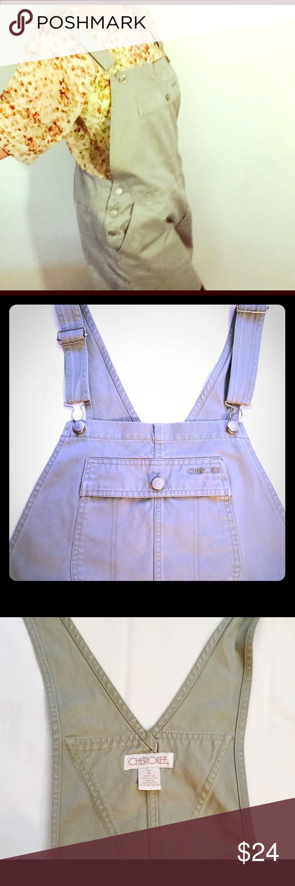 🔵 Vintage Cherokee brand short-alls L Vintage Cherokee short-alls size L. These are in good shape for their age! There is two small stains (barely noticeable) in the legs- check pictures. Also one teeny snag near left pocket (minuscule). Great gray green color! These are so awesome!! Great 80's cargo features. Silver colored hardware. Listing is for shortalls only Cherokee Shorts Jean Shorts