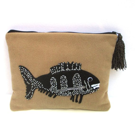 Exotic black fish hand embroidered with white beads on beige