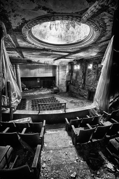 Abandoned theatre in Buffalo. Stunning details are still preserved in the ceiling and around the dome in this view from the balcony.