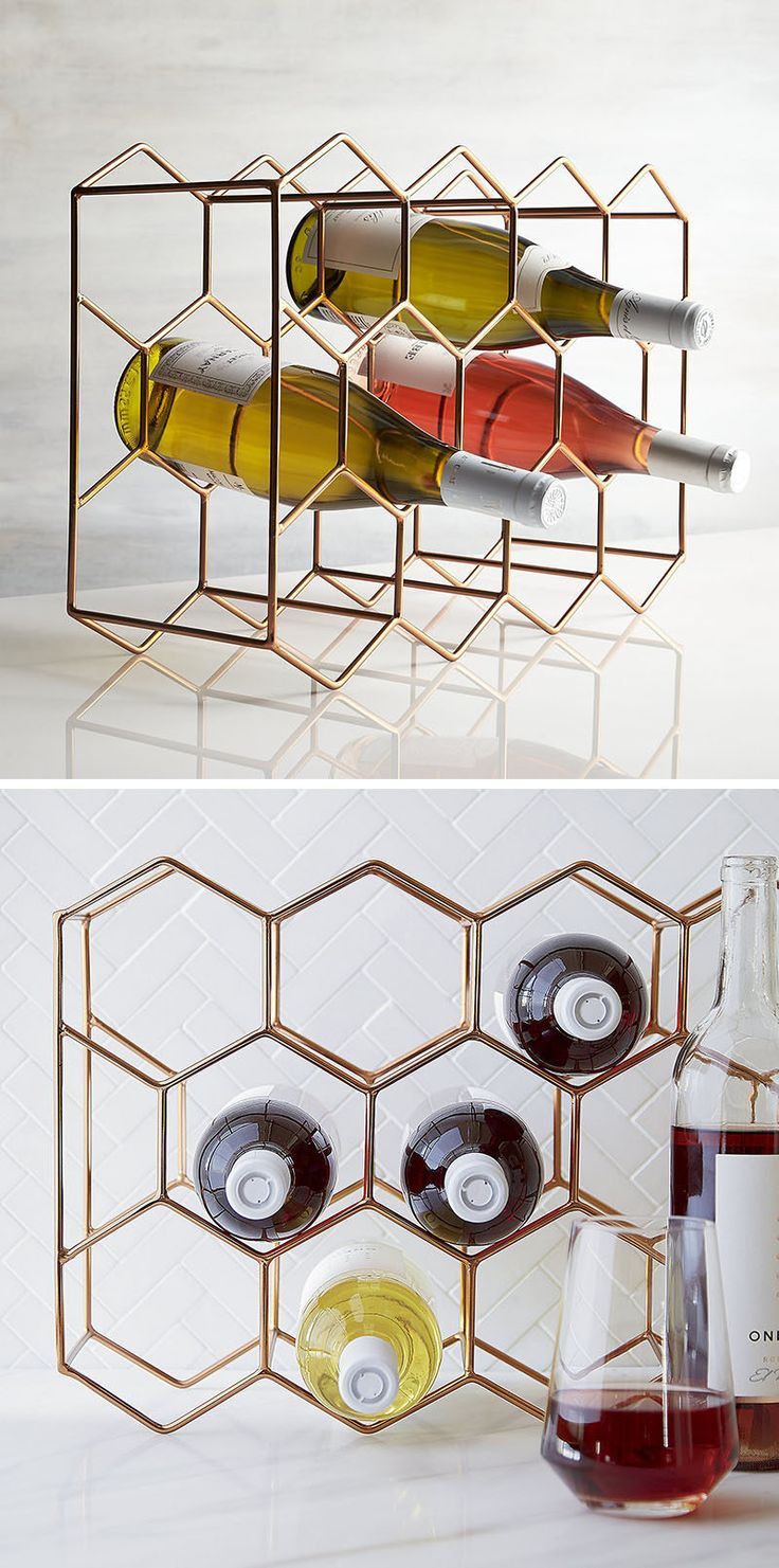 13 Wine Bottle Storage Ideas For Your Stylish Home // This sleek copper wine rack can hold 11 bottles of wine within the hexagons on both sides.