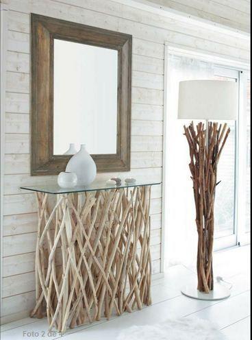 muebles para decorar el hall con estilo un recibidor de cristal y ramas