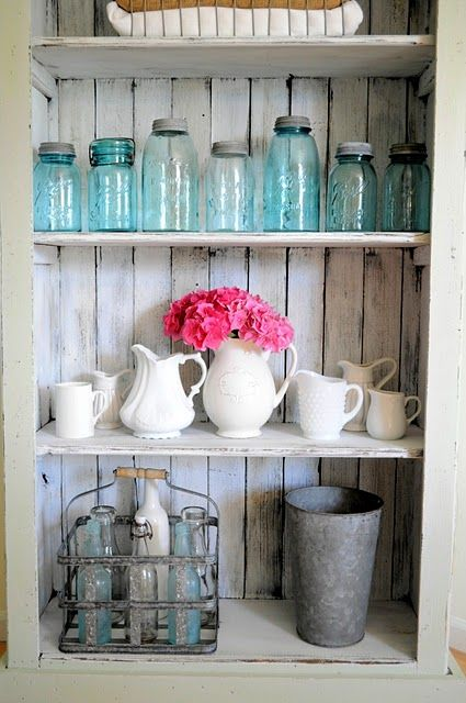 old blue jars, milkglass, and vintage bottles, distressed wood...everything I…