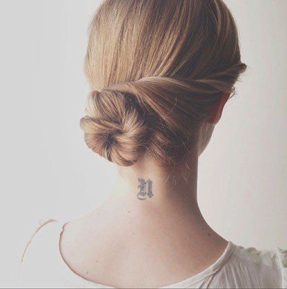 Hairstylist Kristin Ess created this gorgeous twisted side bun that works for any hair texture.