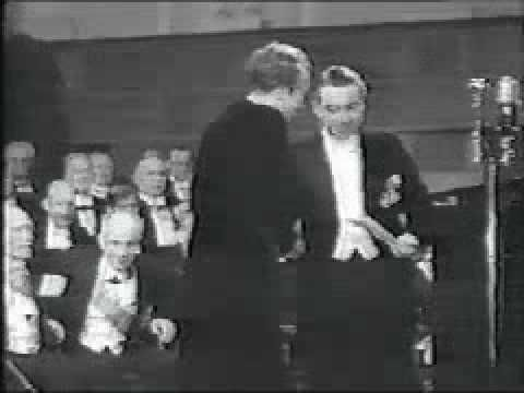 News clip showing Mistral accepting the Nobel prize. Her delivery of the banquet speech is not included, but the video does provide a visual of her and of the ceremony.
