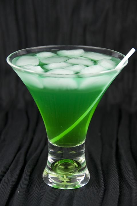 2 oz. Coconut Rum 1/2 oz. Blue Curacao Liqueur 3/4 oz. Melon Liqueur (such as Midori) Pineapple Juice ice