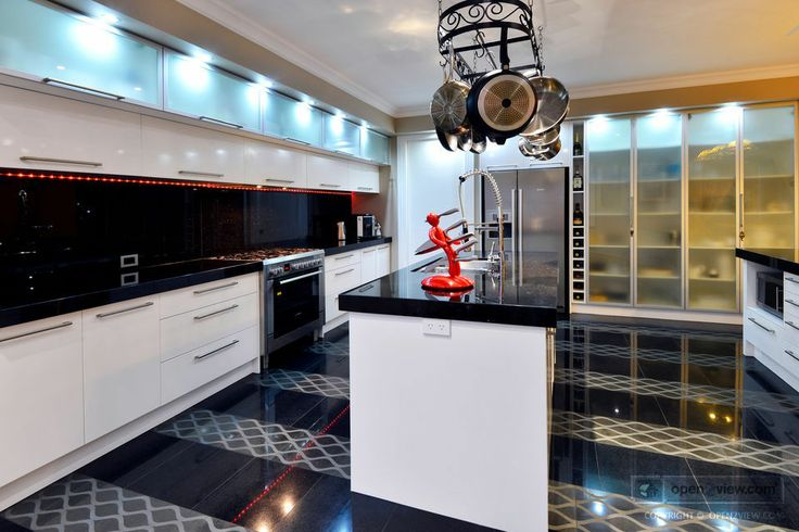 "Perfect space for the entertainer: Custom chefs kitchen  butler's pantry and two floating island bench tops in granite. Love ""The Ex"" red knife holder!"