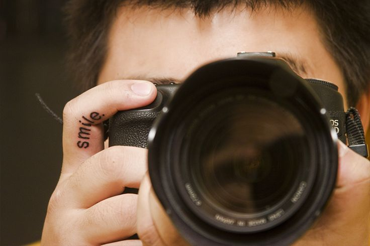 Photographer's finger. tattoo art.