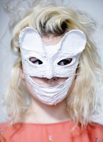 "Kamo mask worn by Olivia Bee — ""The mask is a white fox. In Japan, a white fox is the incarnation of God.""—Kamo"