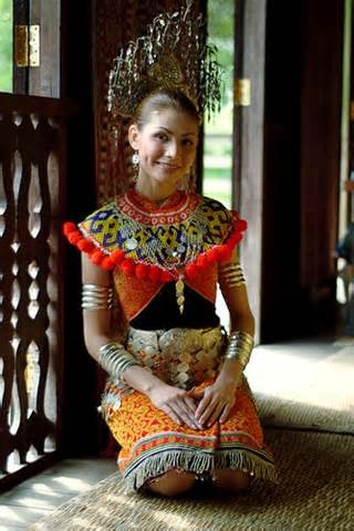 Iban girl in traditional dress (Iban is a branch of dayak peoples - natives of island of borneo, Malaysia)
