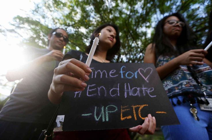 Filipino members of the LGBT (Lesbians Gays Bisexuals Transgenders) community light candles during a vigil to pay tribute to the victims of the Orlando, Fla. mass shooting Tuesday, June 14, 2016 at the University of the Philippines campus in suburban Quezon city northeast of Manila, Philippines. A gunman, later identified as Omar Mateen, opened fire inside a crowded gay nightclub early Sunday before dying in a gunfight with responding SWAT officers, authorities said.(AP Photo/Bullit…