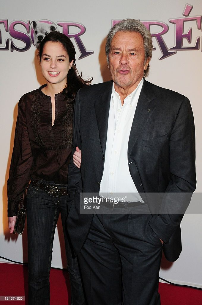 PARIS, FRANCE - NOVEMBER 09 Actor Alain Delon and his daughter Anouchka Delon (L) attend the 'Tresor' Paris Premiere at the Cinema Gaumont Capucines on November 9, 2009 in Paris, France.