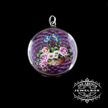 Sweet little silver enamel Edwardian locket with basket of flowers detail.