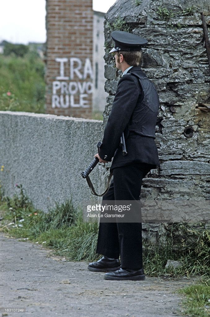 KINGDOM. SEPTEMBER 1978. RUC on border patrol in village of Clady, County Tyrone, Northern Ireland during The troubles.