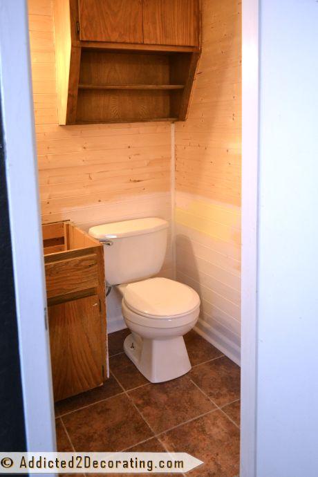 Tiny Bathroom Makeover Progress - new toilet, flooring, and trim