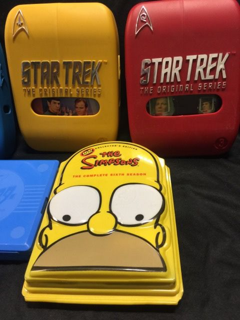 LOT INCLUDES A COLLECTORS EDITION THE SIMPSONS TV SHOW 4 DVD SET PLUS THREE STAR TREK BOXED DVD SETS OF SEASON 1, 2 AND 3. THIS LOT ALSO INCLUDES A HARD PLASTIC CASE FILLED WITH NINTENDO POCKET MONSTERS COLLECTORS STICKER/CARDS.