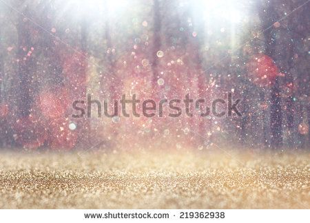 blurred abstract photo of light burst among trees and glitter bokeh lights. filtered image and textured.  - stock photo
