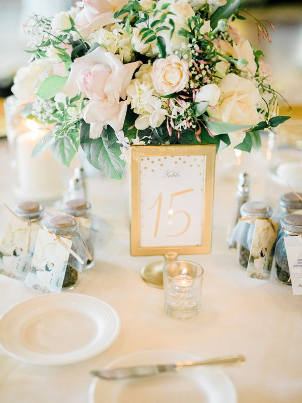 gold table number - photo by Honey Honey Photography http://ruffledblog.com/stylish-pacific-palisades-beach-wedding
