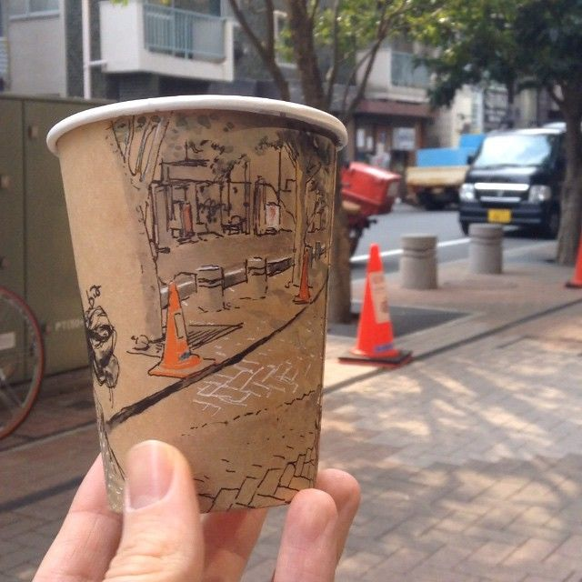 Tokyo-based illustrator Adrian Hogan created a fun series of sketches where he drew panoramic views of streets and sidewalks around the outside of his coffee cups.