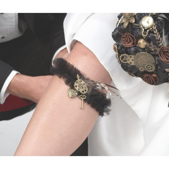 No Steampunk Themed Wedding is complete without a bridal garter with a Steampunk Wedding Theme. Embrace all of the good qualities that the steampunk style has to offer via this black tulle garter with an antique bronze heart, key, gears and feathers.