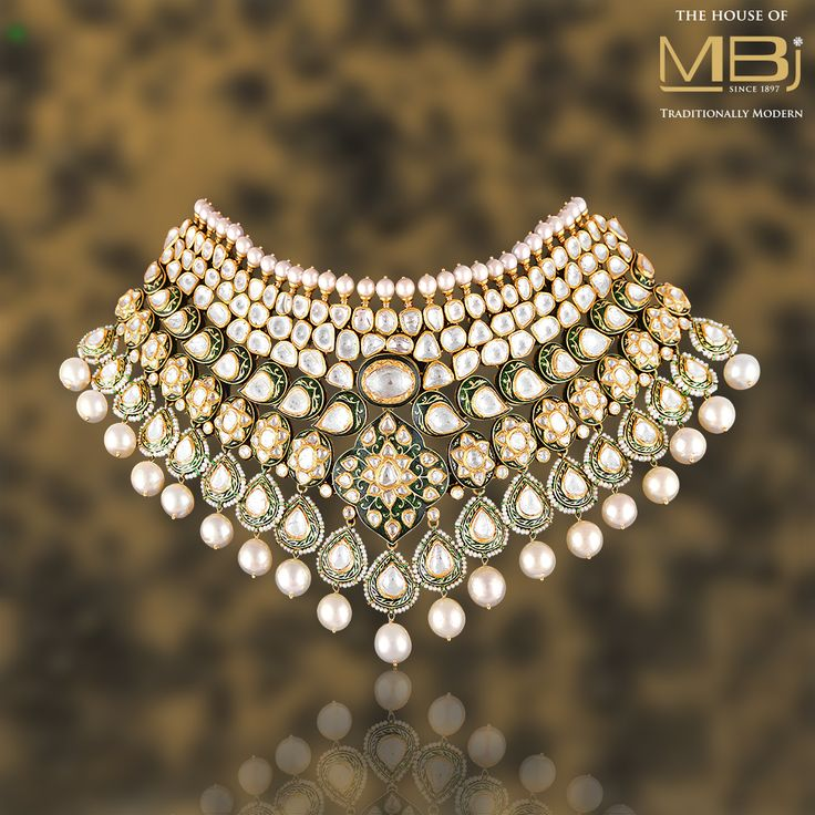Meticulously studded with a beguiling #emerald stone, this #diamond #Necklace is a perfect combination of elegant designs and beautiful craftsmanship. #MBjIndia #Necklace #Bridal #Diamondjewellery #Luxury