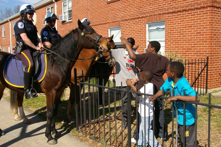 The Mounted Squad makes some new friends in Gilpin Court where many children and adults have never seen a horse