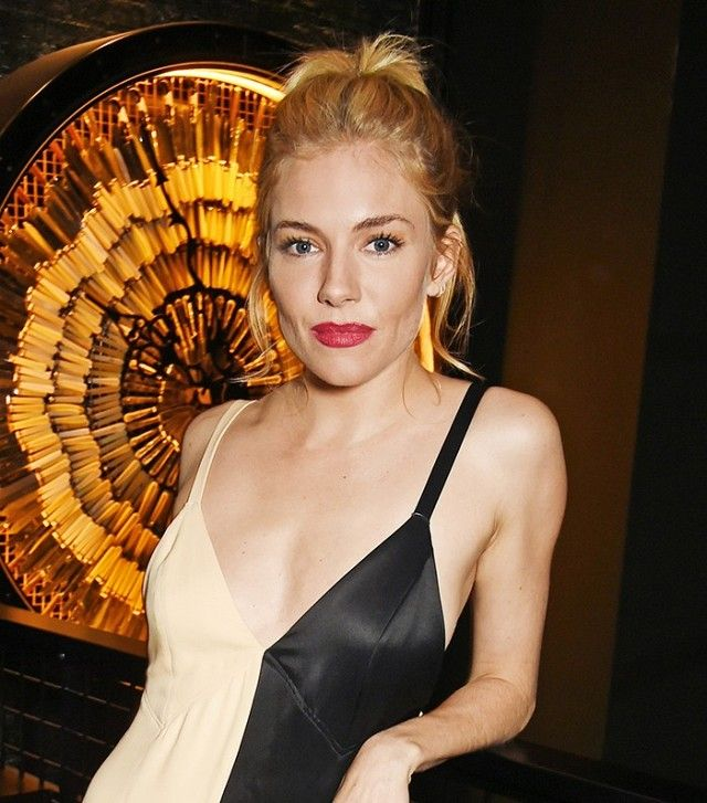 Loving Sienna Miller's '90s styled high ponytail and statement lip color