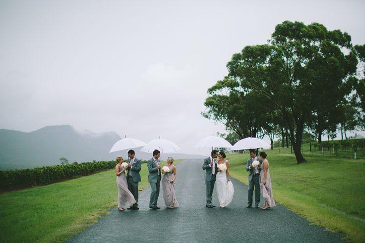 Wet weather wedding photo.  Hunter Valley wedding photography Image: Cavanagh Photography http://cavanaghphotography.com.au