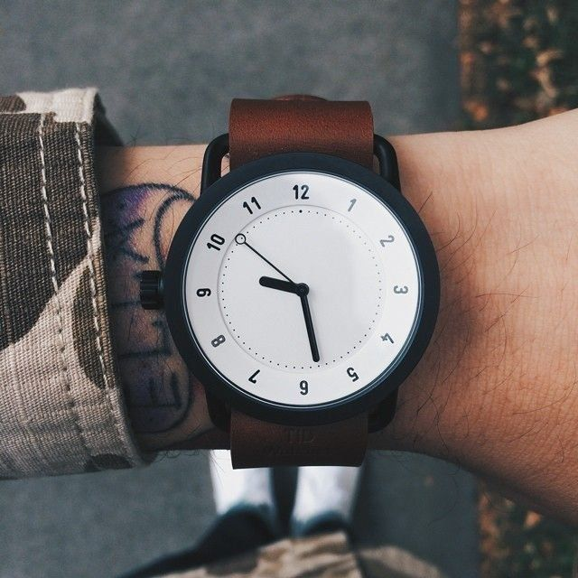 """""""Tid"""" is Swedish for time. The No.1 comes in stainless steel with black ion plating - a resilient deep surface treatment. The inside holds a Japanese quartz clockwork. The watch is accompanied with a Walnut Leather Wristband and a woven nylon NATO wristband without screws or hinges. This particular watch is finished with a white face. Case: Stainless SteelStraps: Walnut vegetable tanned Italian Leather wristband / Woven Nylon NATOMovement: Japanese QuartzDial Colour: White"""