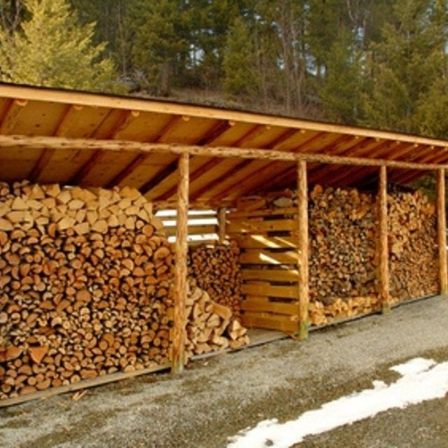 You can put up wood slats for walls on a sloped roof shed.
