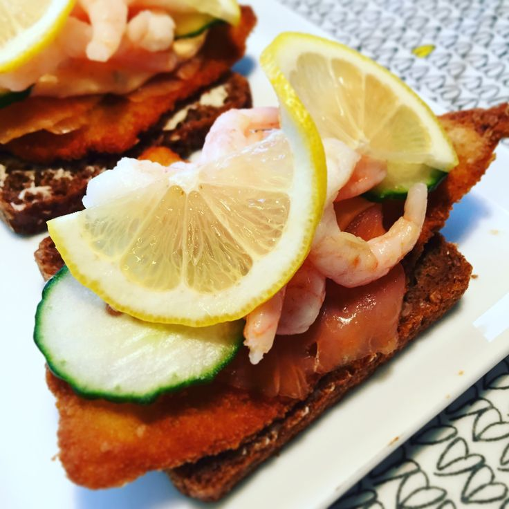 """""""Stjerneskud"""" - """"Shooting Star"""" in Danish. An open sandwich with fried fish, smoked salmon and boiled shrimps on a sliced eye bread."""