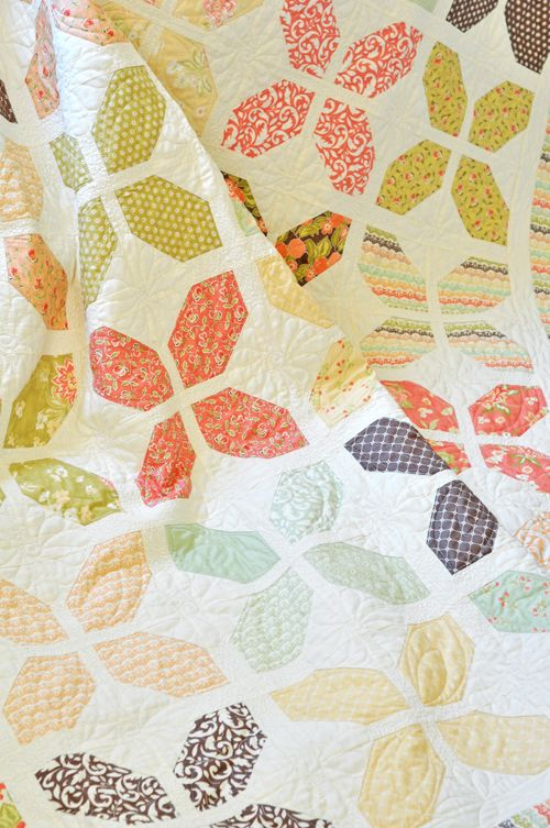 Quilt is made with 1 Layer Cake and 1 Charm Pack, along with a coordinating middle border and background