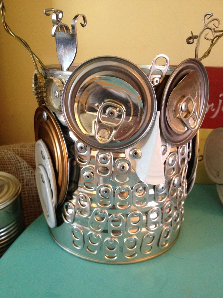 Tin Can Alley -- Repurposed and Reloved by Janet Buhl Moody Avery at  tincanalleyreloved@gmail.com  Owl made from recycled #10 tin can, pop tops, can lids, forks and clothes hangers.