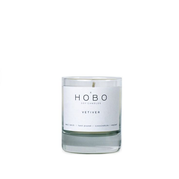 The Vetiver Candle by Hobo Soy Candles features a deep woody fragrance with a touch of fresh citrus from the classic Indian Vetiver grass. A fresh masculine scent designed to compliment your home. Vetiver Candle by Hobo Soy Candles is available at Osmology. Shop your favourite boutique scented candles and home fragrance brands in one place.