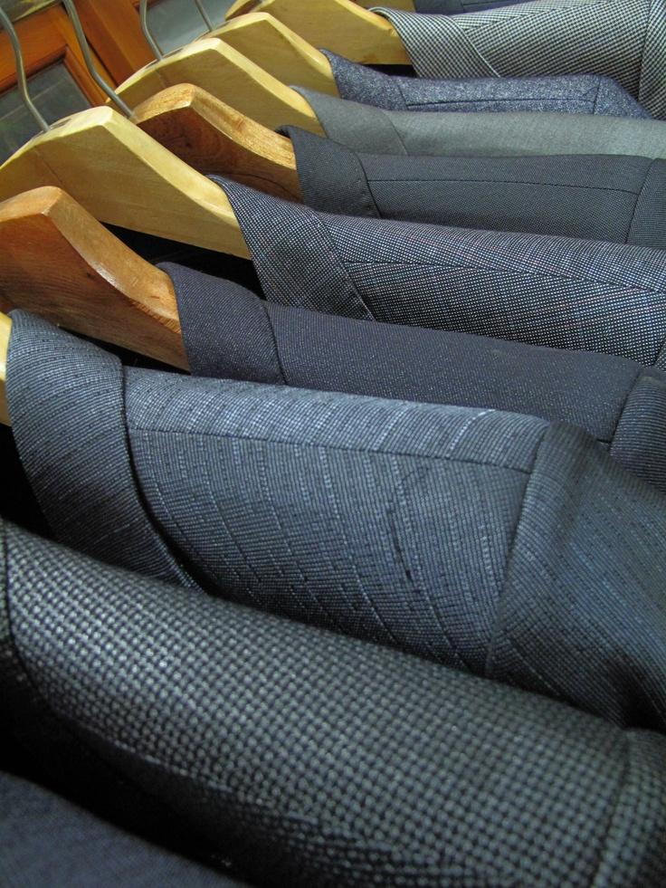 Full rack of men's custom tailored suits