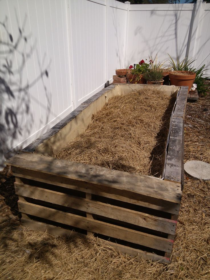 This is our raised bed garden for 2014. We used 6 pallets. We cut about 18in. off the bottom of each pallet then screwed the pallets together. We closed off the top of the pallets by recycling wood from our former raised bed garden.The inside is lined with a cotton sheet and burlap to hold the dirt in. We filled it 2/3 of the way full with hay. We will add a layer of compost,manure and top soil. Then it will be time to plant!