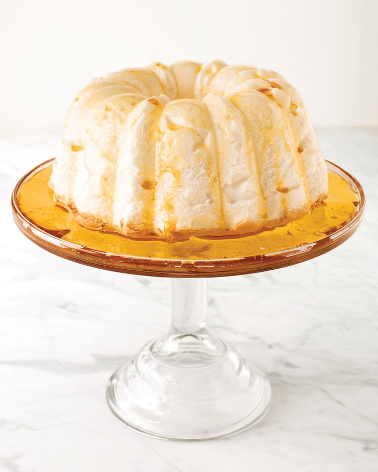 "Top airy meringue with silky creme anglaise and sticky-sweet caramel to create this ""floating island."""