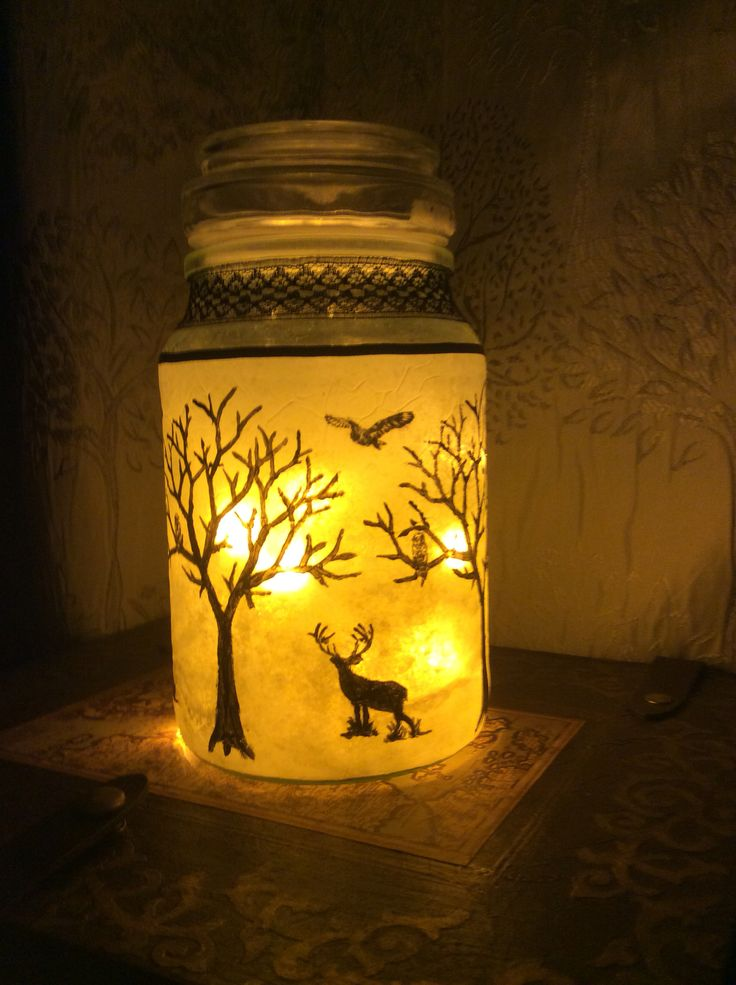 A lamp I made from an empty jar and fairy lights