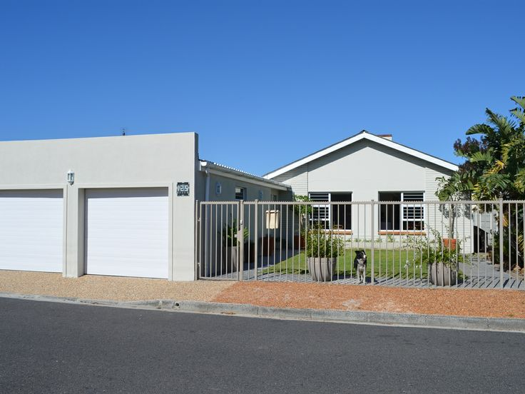 PLUMSTEAD - CAPE TOWN.  Double volume ceilings cover the open plan lounge with fire place, dining room and kitchen. Aluminium windows throughout and parquet flooring. 3 bedrooms with built in cupboards, 2 bathrooms (mes) and a study. Aircon/heater and ceiling insulation. PVC facias and seamless guttering. Garden with stunning, fenced  netted pool surrounds the house and is great for kids. Auto double garage with direct access to the house and well point water complete this amazing property.