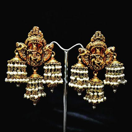 Pair of Lord Krishna earrings in gold, from Karni Jewellers.