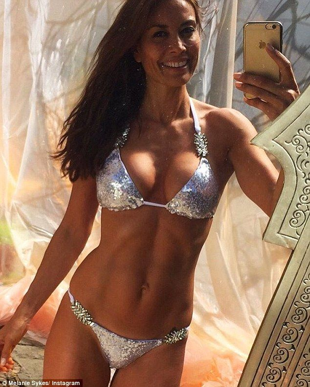 All that glitters! Melanie Sykes, 46,showed off her gym-honed physique while on holiday in Mallorca on Sunday, flaunting her washboard abs on Instagram in an all-over sequin bikini