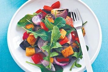 Roasted vegetable salad with rocket and hummus