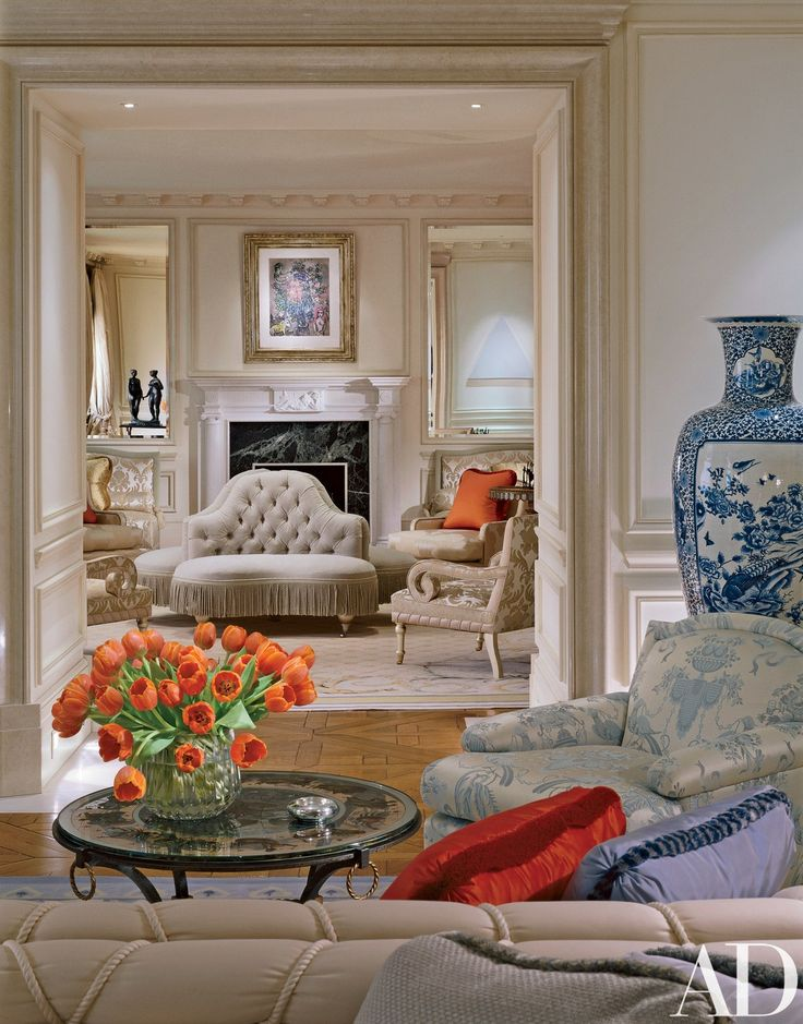 """As the reception rooms flow from one to the other, I used a very neutral palette."""" In the green reception room, the designer hung a painting by Marc Chagall over the fireplace. Reflected in the mirrors are a bronze by Sheila Mitchell and a canvas by Robert Mangold. Stark carpets."""