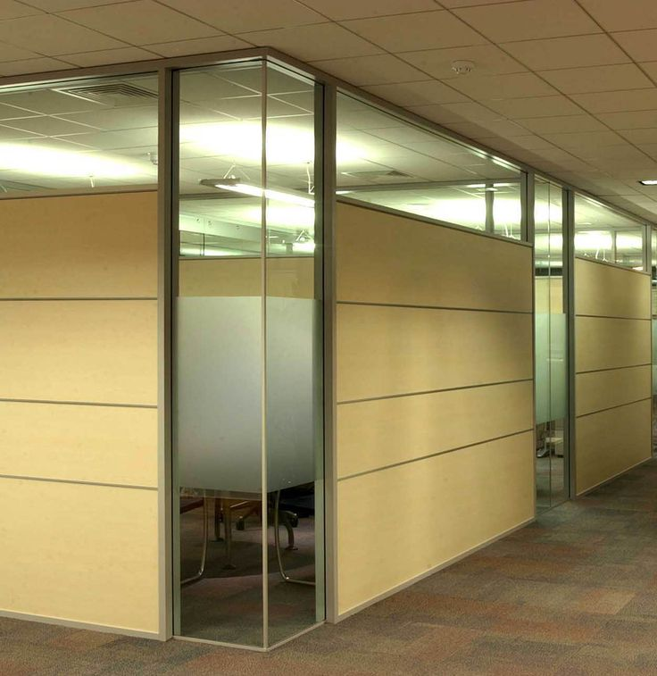 Glass Partition Walls #AS-ROOM-3 Architectural Simplicity can customize glass wall systems to suit any design application. This architecturally pleasing product offers the ability to mix and match glass and other building wall materials to conceal wires, and other building products. Customized glass partition designs are achieved by applying horizontal laminate tiles with vertical glass. Notice the fine detail where the glass meets at the corner.
