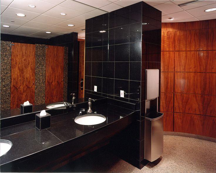 Figured Koa paneling and partition doors give the restrooms a very distinctive appearance #koa #veneer #woodveneer #bohlke