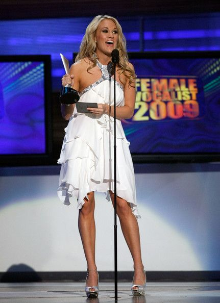 Carrie Underwood Photos Photos - Singer Carrie Underwood accepts the Top Female Vocalist award onstage during the 44th annual Academy Of Country Music Awards held at the MGM Grand on April 5, 2009 in Las Vegas, Nevada.  (Photo by Ethan Miller/Getty Images) * Local Caption * Carrie Underwood - 44th Annual Academy Of Country Music Awards - Show